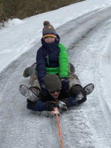 Bossier family sleds during Snowpocalypse 2021.